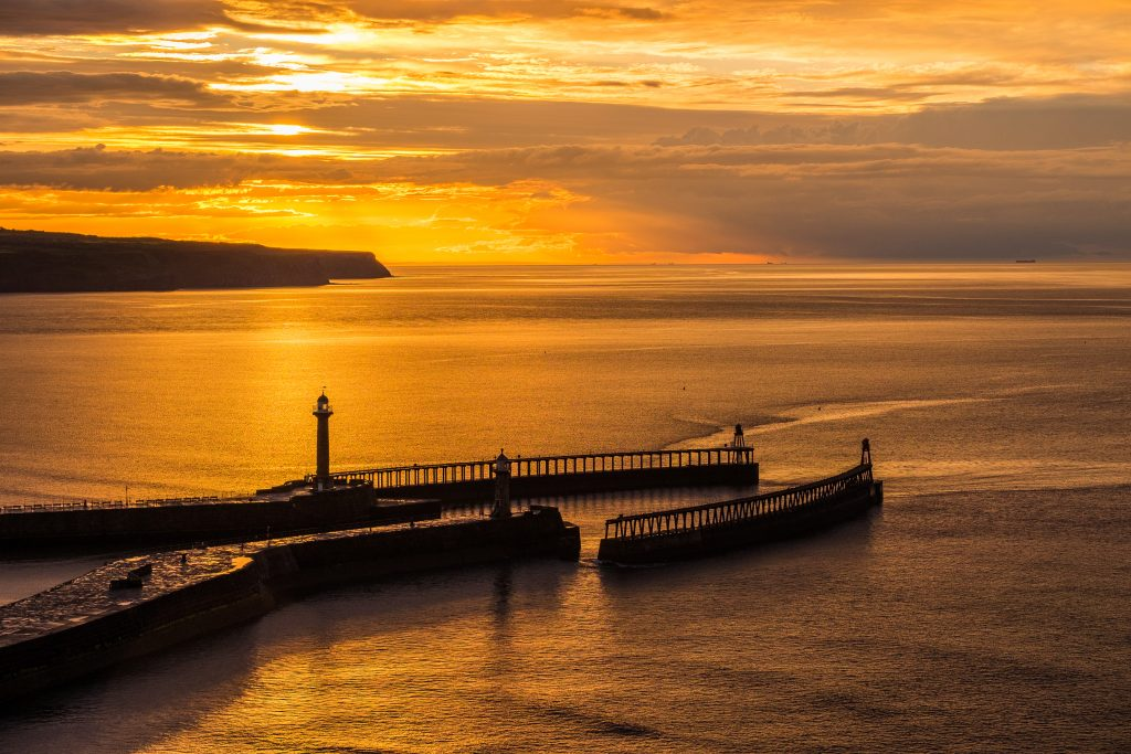 Midsummer Sunset Over Whitby Piers